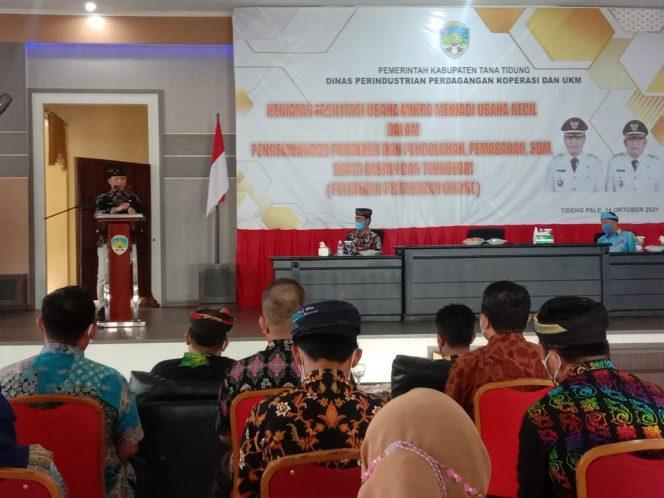 Bupati Tana Tidung, Ibrahim Ali saat memberi sambutan kegiatan fasilitas usaha mikro menjadi usaha kecil dalam pengembangan, produk dan  pengolahan, pemasaran, SDM serta  desain dan teknologi (Pelatihan Pemasaran Online).Foto: Fokusborneo.com