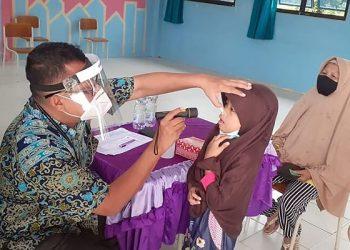 Kegiatan pengobatan gratis pada layanan dokter terbang gelaran Pemprov Kaltara di salah satu kabupaten, belum lama ini. Foto : Humas Provinsi Kaltara
