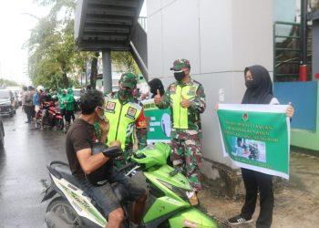 Personil Kodim 0907 Tarakan melaksanakan  kampanye simpatik protokol kesehatan bertempat di Simpang Empat THM. Foto: Fokusborneo.com