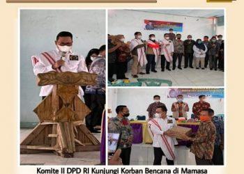Pimpinan Komite II DPD RI Hasan Basri menyerahkan bantuan kepada korban bencana alam di Masama Sulbar, Minggu (14/2). Foto : Istimewa